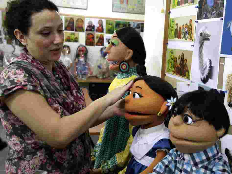 A Pakistani artist in Lahore touches up puppets from Pakistan's Sesame Street. The U.S. Embassy in Pakistan says it has terminated funding for a $20 million project to develop a local version of Sesame Street amid reports of corruption.