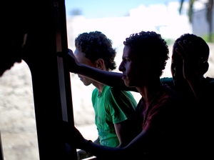 Children ride the train, hopping in and out of the open doors, from Tunis to the suburb of Sidi Bou Said.