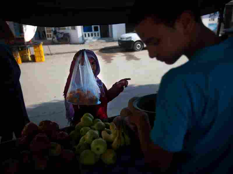 A vendor sells fruit at the Sidi Bouzid market where fruit-seller Mohammed Bouazizi worked. Bouazizi's self-immolation in front of the governor's offices nearby was the catalyst for protests all over the county.