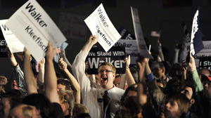 Walker supporters watch returns as they await the governor's speech at an election night rally on Tuesday in Waukesha.