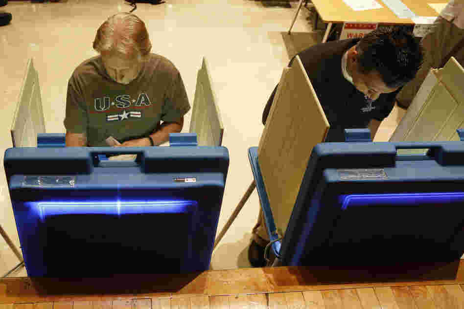 Voters cast ballots in Milwaukee. Critics of the governor gathered more than 900,000 signatures in support of the recall.