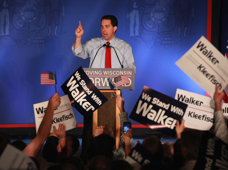 Wisconsin Gov. Scott Walker greets supporters at a rally Tuesday in Waukesha, Wis., after weathering a recall challenge.