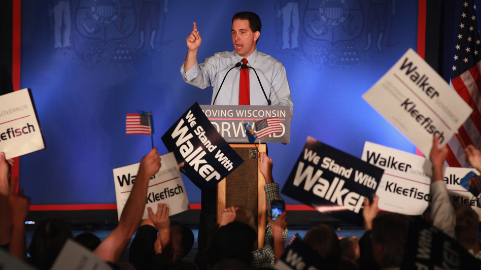 Wisconsin Gov. Scott Walker greets supporters at a rally Tuesday in Waukesha, Wis., after weathering a recall challenge. (Getty Images)