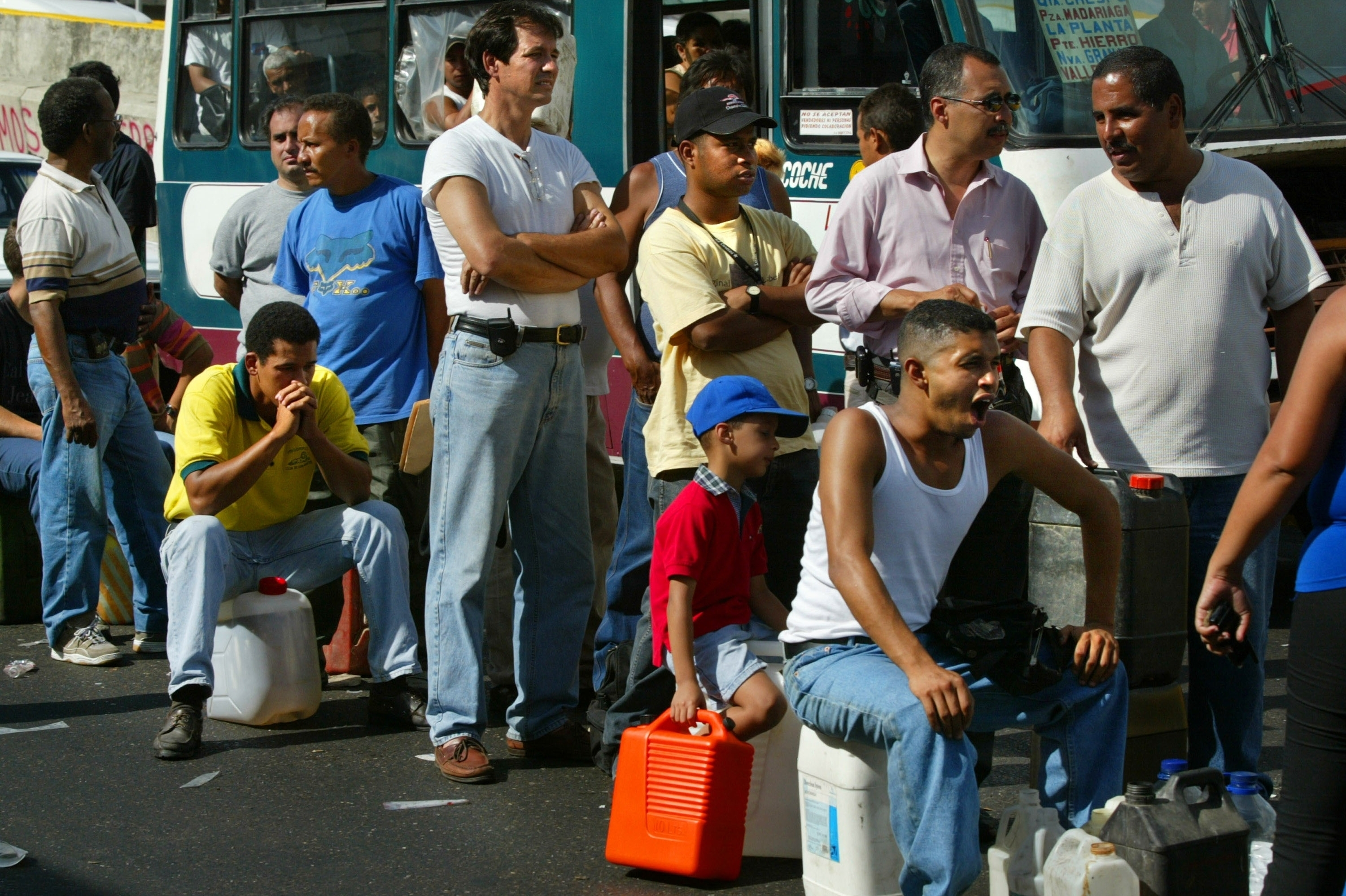 Venezuelans wait for hours in gas lines in Caracas on Dec. 21, 2002, the 20th day of a general strike protesting Chavez's rule. The strike temporarily crippled Venezuela's vital oil industry.