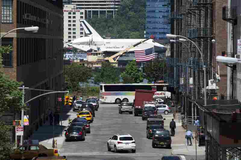 The Enterprise will be hoisted by crane onto the flight deck of the retired Intrepid aircraft carrier.