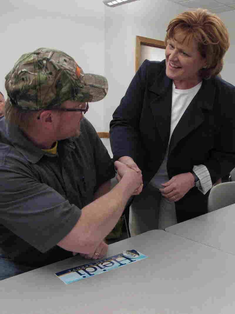 Democratic Senate candidate Heidi Heitkamp greets a supporter before a town hall meeting in Minot, N.D., on May 3.