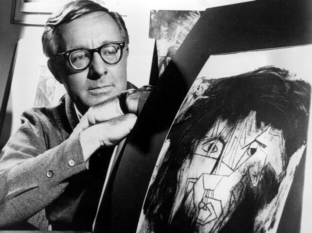 This 1966 file photo shows science fiction writer Ray Bradbury looking at a picture that was part of a school project to illustrate characters in one of his dramas.