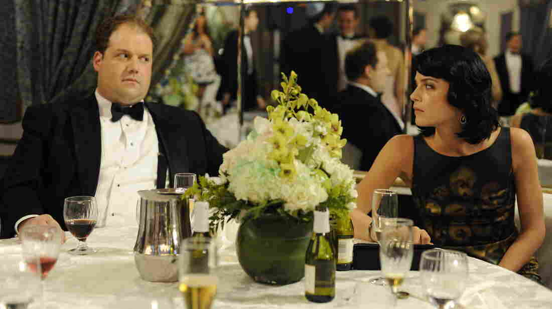 Abe (Jordan Gelber) and Miranda (Selma Blair) meet at a wedding in Dark Horse and get married soon after, though not for the most romantic reasons.
