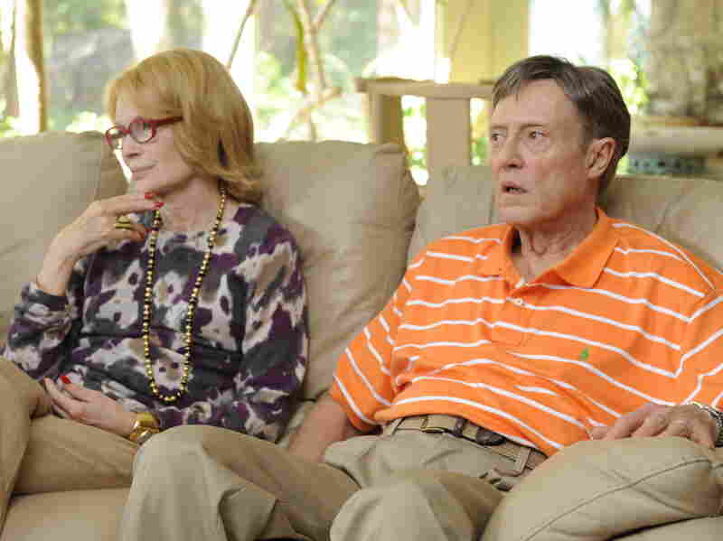 Mia Farrow and Christopher Walken play Phyllis and Jackie, Abe's parents and — in Jackie's case — his employer.