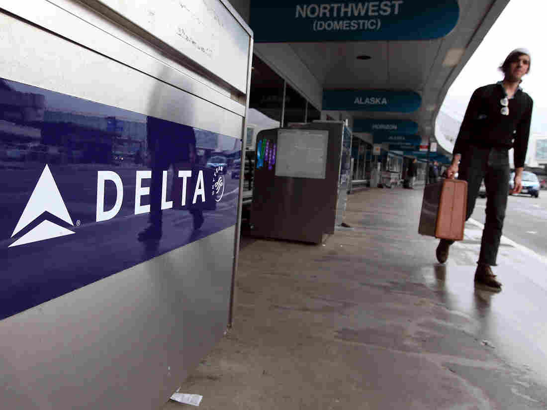 A traveler walks by a Delta Airlines skycap kiosk at San Francisco International Airport.