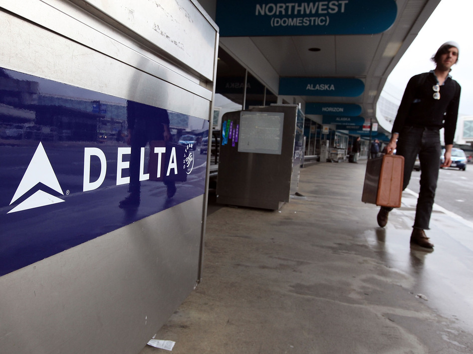 A traveler walks by a Delta Airlines skycap kiosk at San Francisco International Airport. (Justin Sullivan/Getty Images)