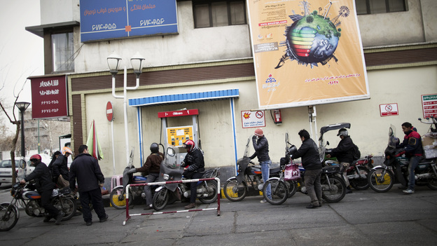 Iranians line up at a gas station to fuel their motorcycles in central Tehran in February. Oil is the lifeblood of Iran's economy, but the planned EU boycott is expected to deal a major blow to Iranian oil exports. (AFP/Getty Images)