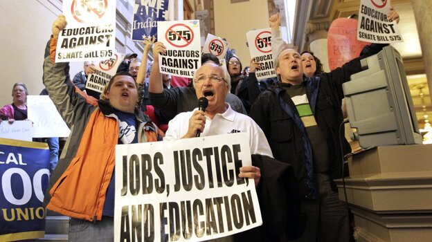 Rick Muir, president of the Indiana Federation of Teachers, chanted with other protesters at the Statehouse in Indianapolis in February 2011 over legislation limiting collective bargaining for teachers. Months later, it became law.