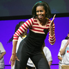 """More than 10,000 children from Iowa schools joined Michelle Obama during the """"Let's Move"""" interactive celebration in Des Moines last February."""