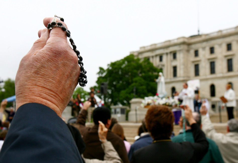 Catholics gather outside the Minnesota Capitol in St. Paul for the Family Rosary Procession on May 6. They marched from the Capitol to the Cathedral of St. Paul in support of an amendment that would define marriage as between one man and one woman.