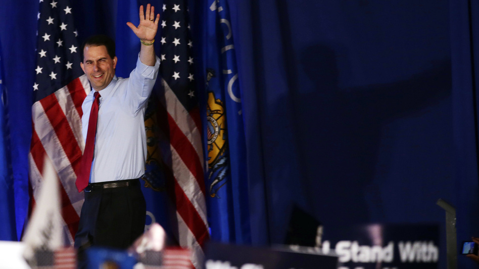 Wisconsin Gov. Scott Walker waves at his victory party Tuesday in Waukesha, Wis. The Republican survived a recall election in the state, defeating his Democratic rival, Tom Barrett. (AP)