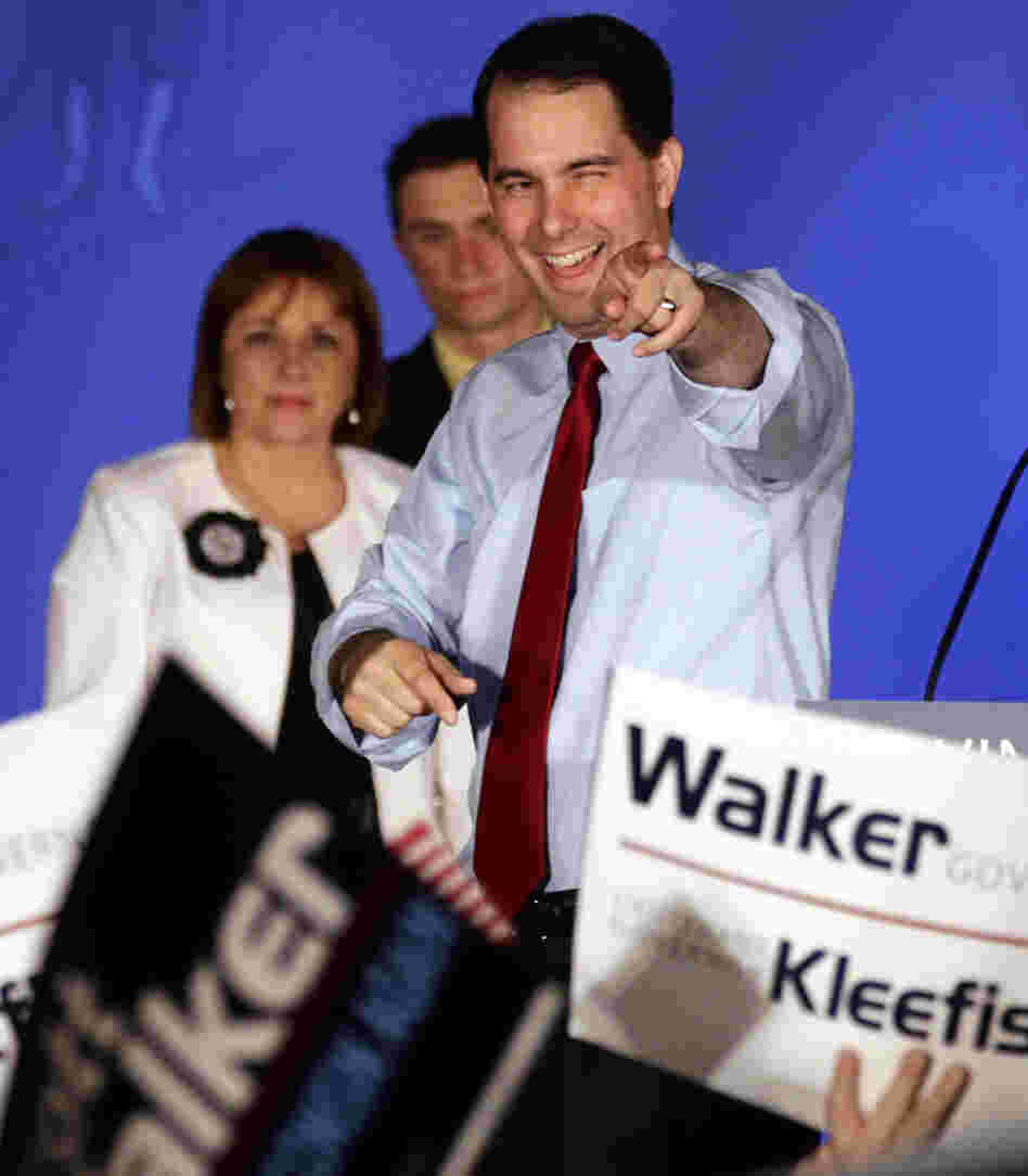 Wisconsin Republican Gov. Scott Walker (right) celebrates his win over Democratic challenger Tom Barrett at Tuesday night's victory party in Waukesha, Wis.