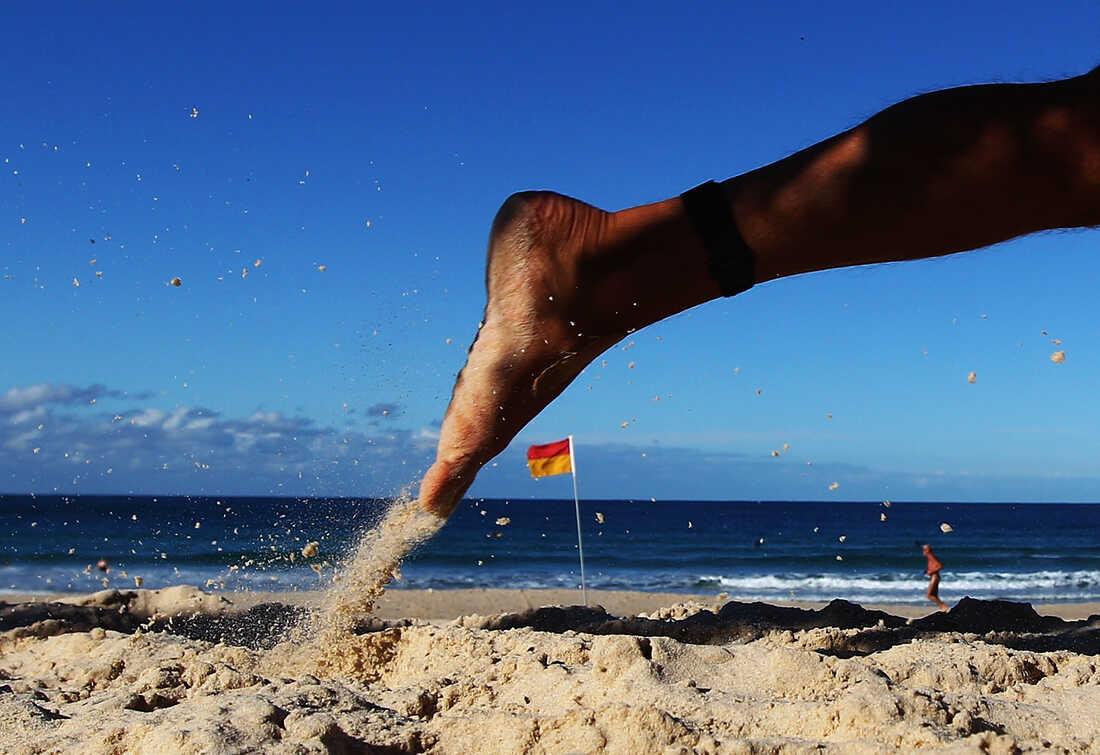 A competitor runs along the beach during the 2012 Bondi Barefoot Race at Bondi Beach on May 27, 2012 in Sydney, Australia.