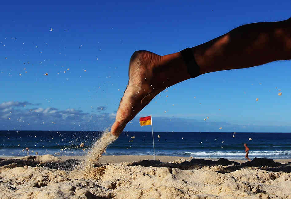 A competitor runs along the beach during the 2012 Bondi Barefoot Race at Bondi Beach on May 27, 2012 in Sydney, Australia.