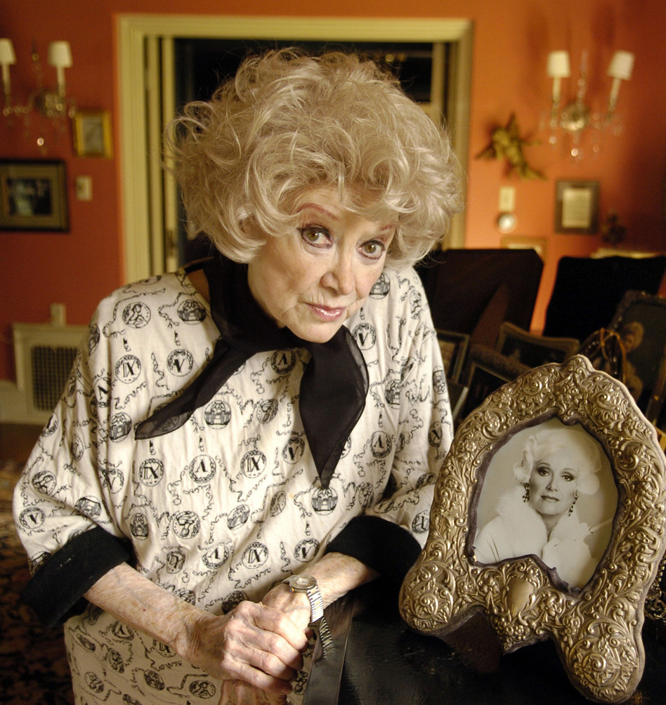Diller poses with a photo at her Los Angeles home in 2005.