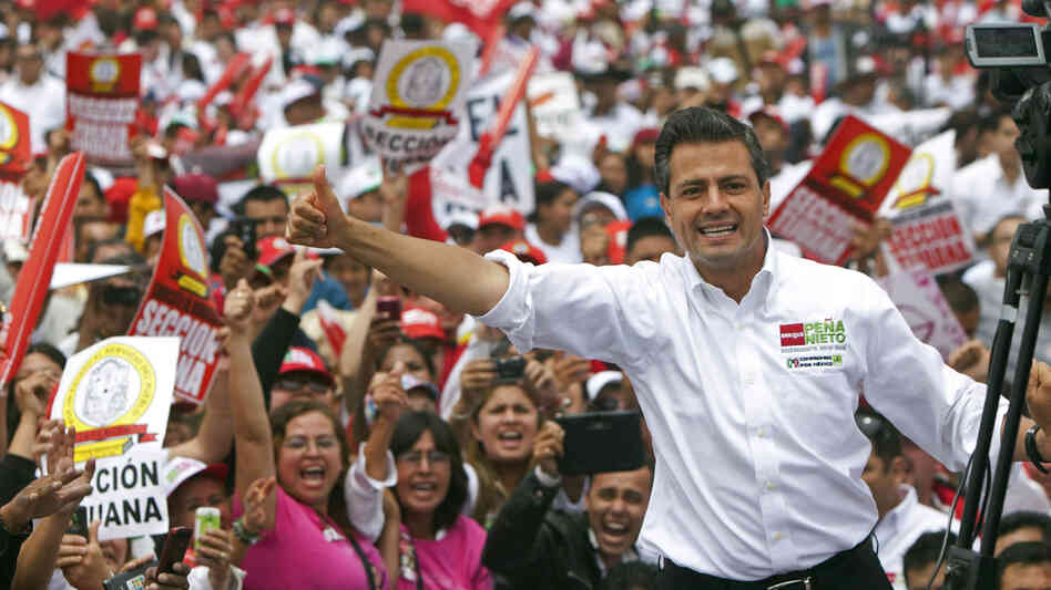 Mexican presidential front-runner Enrique Pena Nieto of the Institutional Revolutionary Party, or PRI, waves to the crowds