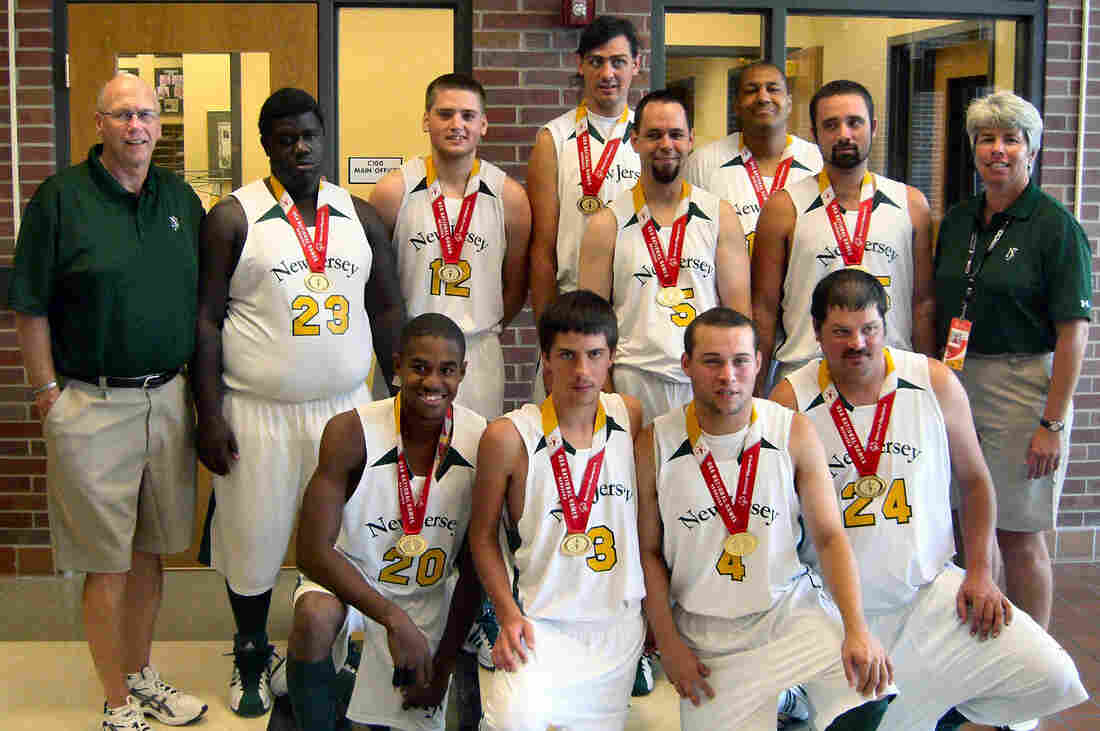 """Champions: The New Jersey basketball team --€"""" including Jose Rodriguez (kneeling, second from right) --€"""" poses for the cameras after winning the gold medal at the Special Olympics National Games in 2010."""