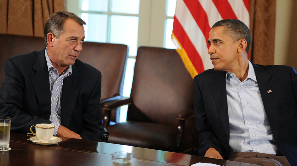 "President Obama speaks with House Speaker John Boehner during a meeting at the White House in 2011. A slowdown in job growth and a looming tax deadline could force the president to try to revive his ""grand bargain"" with Republicans. (AFP/Getty Images)"