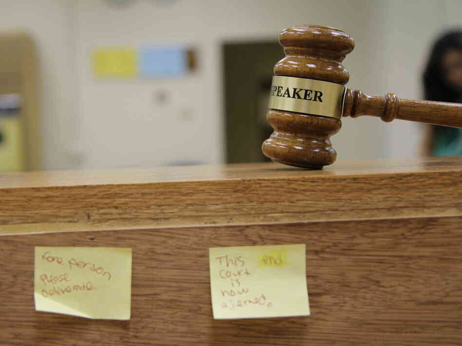 A gavel rests in a makeshift courtroom at Richmond High School in Richmond, Calif. The  local school district has cut the number of student suspensions in half in six years by adopting a y