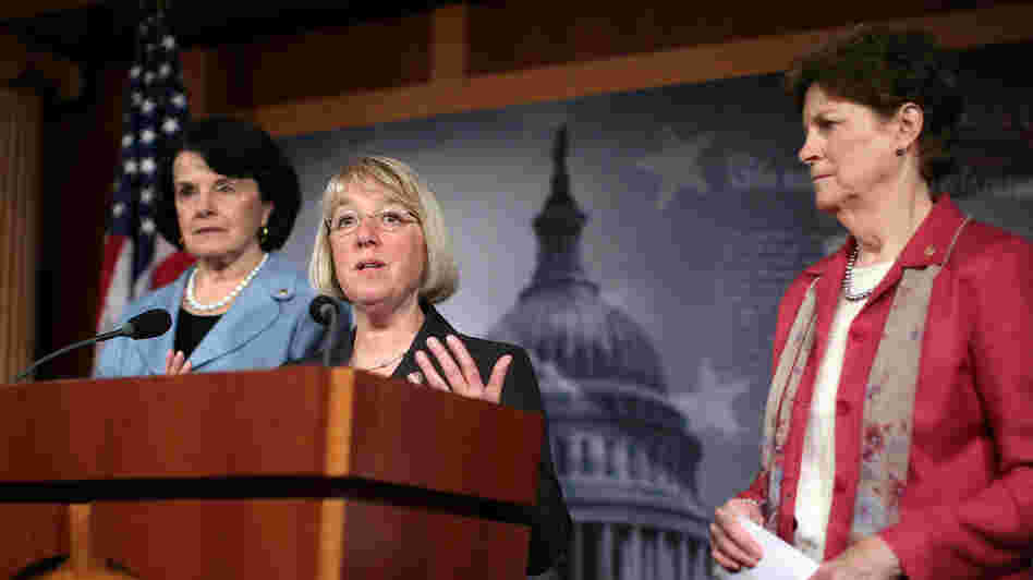 U.S. Sen. Patty Murray (D-Wash.), center, speaks as Sen. Jeanne Shaheen (D-N.H.), right, and Sen. Dianne Feinstein (D-Calif.)  at a April news conference on Capitol Hill.
