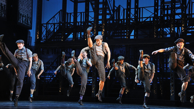 """The idea behind Ost's design was to keep the set out of the way of the storytelling --€"""" and of Newsies' kinetic ensemble. (Getty Images)"""