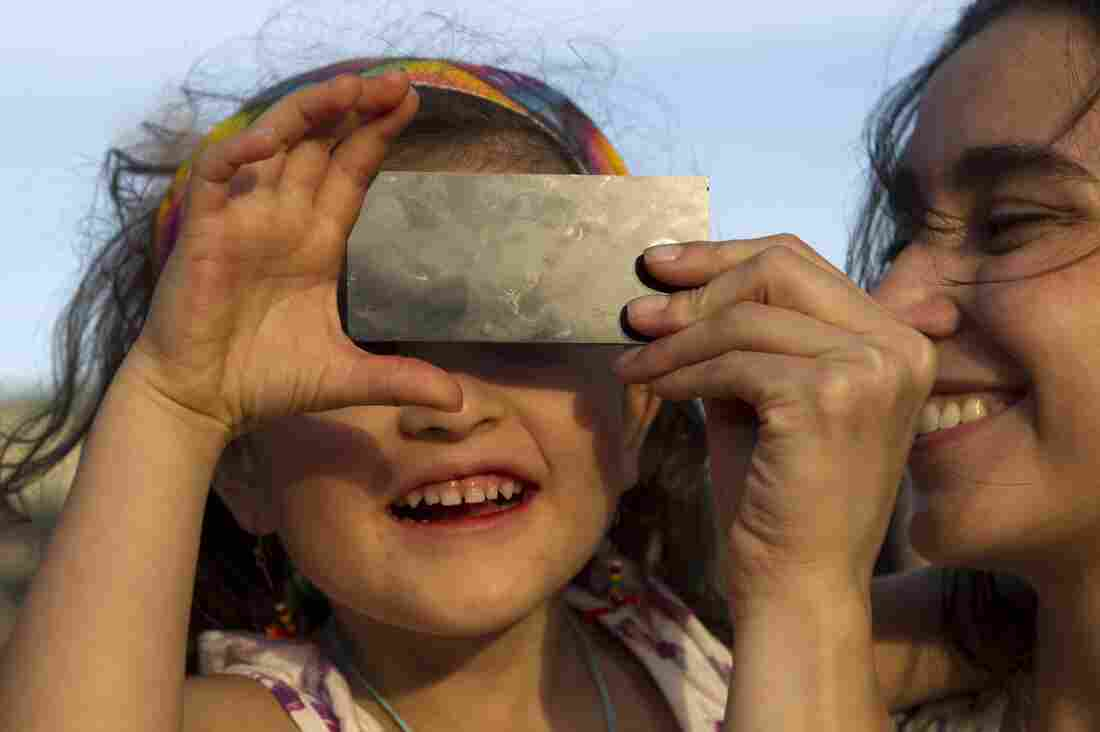 """A """"little scientist"""" watches the transit of Venus across the face of the sun on June 5, 2012, in Medellin, Colombia."""