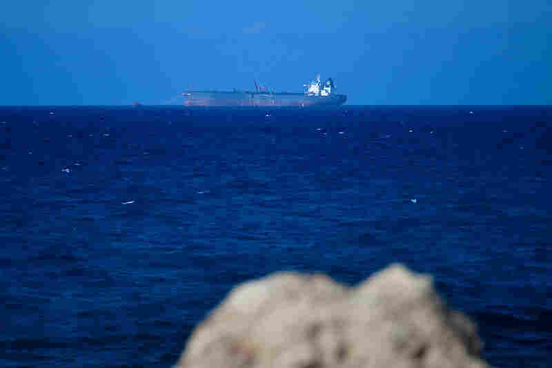 An oil tanker sits off the coast of Al-Sidra, filling its tanks with oil from an undersea pipeline. Oil production crashed during last year's fighting, but is now approaching pre-revolutionary levels.