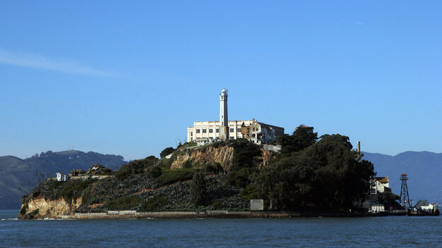 """Sometimes referred to as """"The Rock,"""" Alcatraz Island on San Francisco Bay in California served as a lighthouse, then a military fortification, and then a federal prison until 1972, when it became a national recreation area. Now the island is open to tours."""