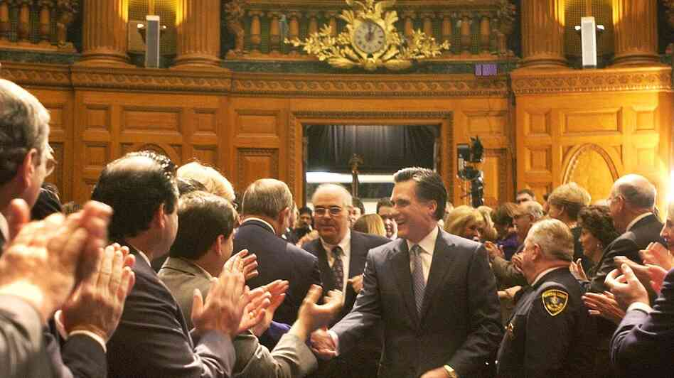 Mitt Romney, then the governor-elect of Massachusetts, walks into the House chambers during inaugural ceremonies at the Statehouse in Boston, on Jan. 2, 2003.