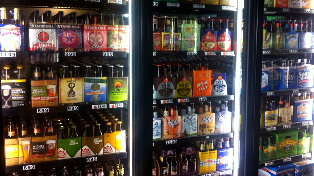 Craft brewers are reaching markets far from their home breweries. In a Washington, D.C., store, beers from California, Colorado, Louisiana, Vermont, and elsewhere are for sale. (NPR)