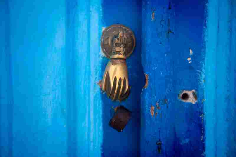 The real Kairouan is a Muslim holy city, was an early foothold for Islam as it spread across North Africa. Most of the door knockers in old-town Kairouan are in the shape of a hand. It symbolizes the hand of the prophet Mohamed's daughter Fatma.