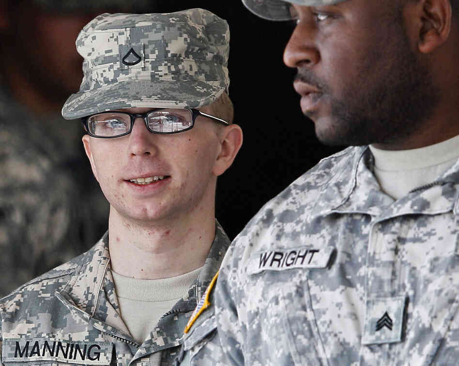 Army Pfc. Bradley Manning, left, is escorted from a courthouse in Fort Meade, Md., on Thursday.