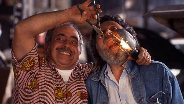 Ray, left, doing some dental work on Tom. (CarTalk.com)