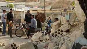 Late last month, people gathered near a home that had been destroyed by fighting in al-Latamneh, Hama Province, Syria.