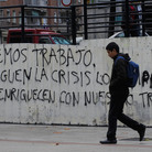 Graffiti on a wall in Madrid reads,