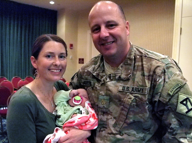 Maj. Matthew Porter, his wife, Jennifer, and their 3-month-old daughter attended the Yellow Ribbon event. They say the deployment strained their relationship, but they are working to keep their marriage healthy.