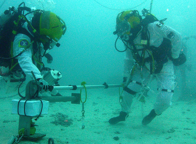 Astronaught Shannon Walker of NASA and astronaut David Saint-Jacques of Canada test moving a probe in the waters off Key Largo, Florida. The program, part of NASA Extreme Environment Mission Operations (NEEMO) is meant to test equipment and man's reactions for a human rendezvous with an asteroid.
