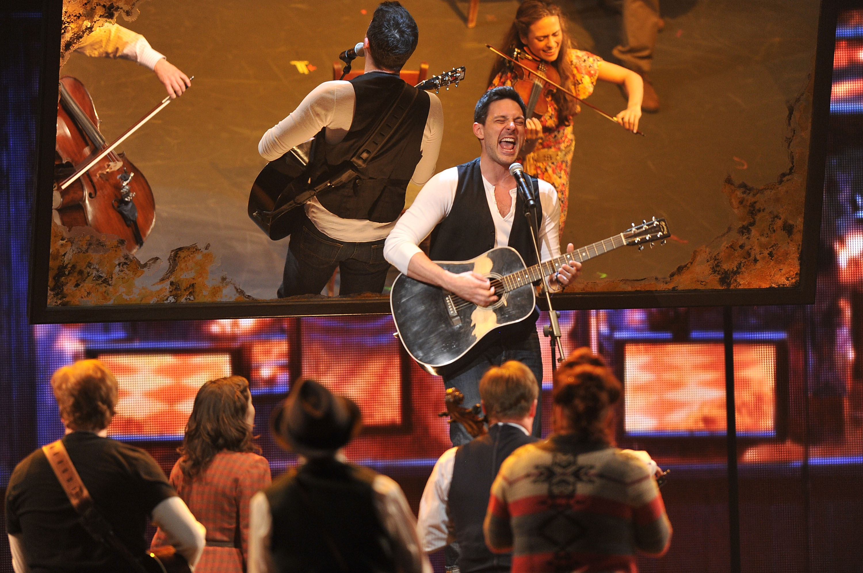 New-minted Tony winner Steve Kazee performs with the cast of Once on the awards broadcast.