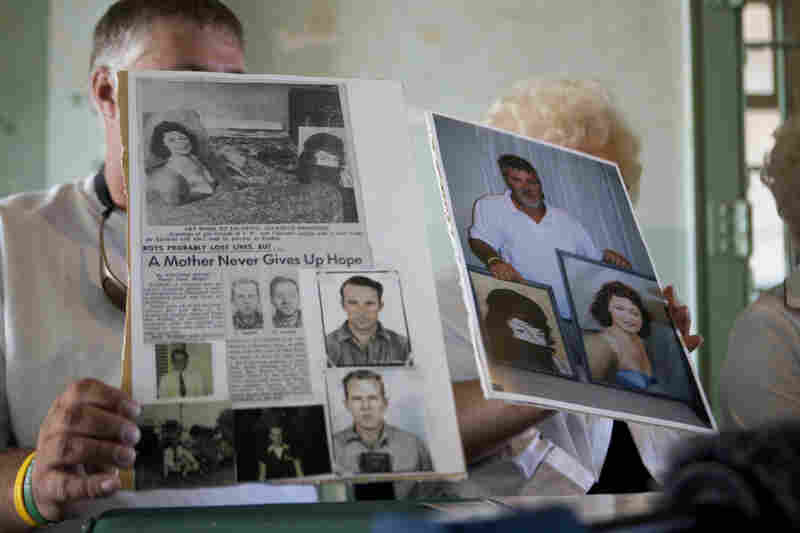 Dave Widner holds up an article about his uncles, inmates John Anglin and Clarence Anglin.