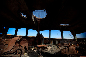 A destroyed building in Misrata holds the damaged remains of tanks that belonged to Moammar Gadhafi's forces.