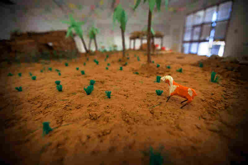 A diorama at the Tawargha refugee camp that represents their old home.