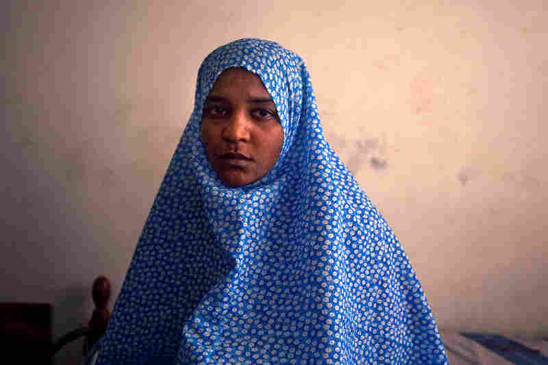 Houda Mohammed Belaid says that when she and her sister joined a protest march against their status as refugees from Tawargha, gunman attacked the protest march and shot them.