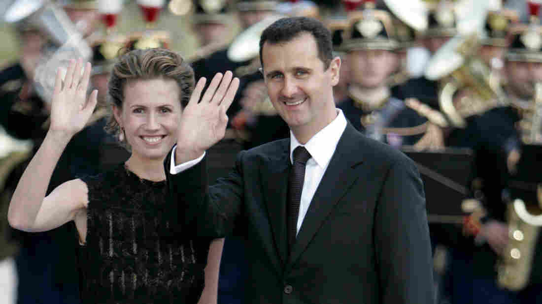 Syrian President Bashar Assad and his wife Asma arrive for a formal dinner after a Mediterranean Summit meeting at the Petit Palais in Paris in 2008.