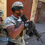 Syria's turmoil has been spreading into Lebanon, where residents say Syrian soldiers have crossed the border and killed civilians. Here, Lebanese army soldiers patrol in the northern port city of Tripoli, Lebanon, earlier this month, where clashes broke out between pro- and anti-Syria gunmen.