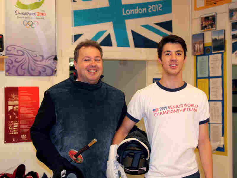 U.S. fencer Alexander Massialas pauses during practice with his father and coach, Greg Massialas.